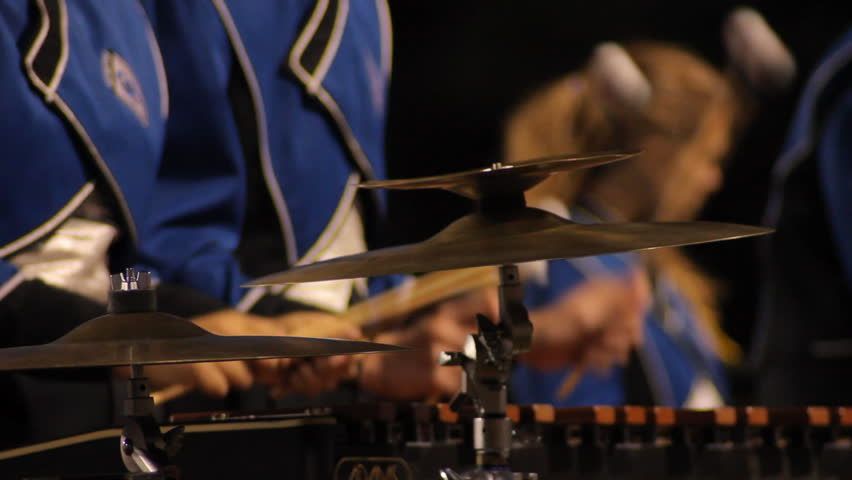 Close up of a marching band member playing the xylophone.