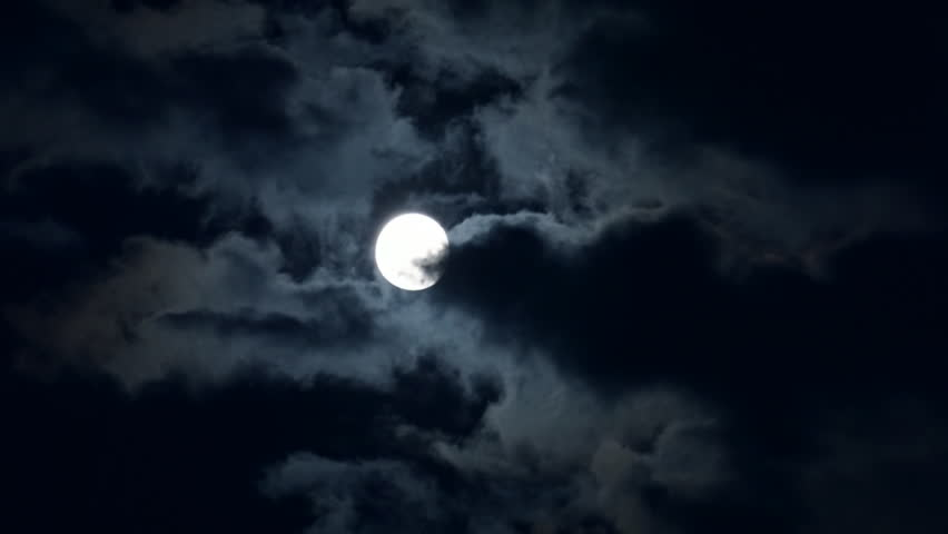 Full moon shining bright behind clouds at dark night. Time lapse | Shutterstock HD Video #10584227