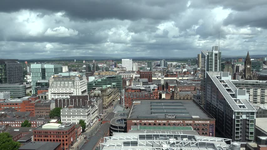 ULTRA HD 4K Timelapse of clouds pass over Manchester downtown, skyline with tourism attraction by day