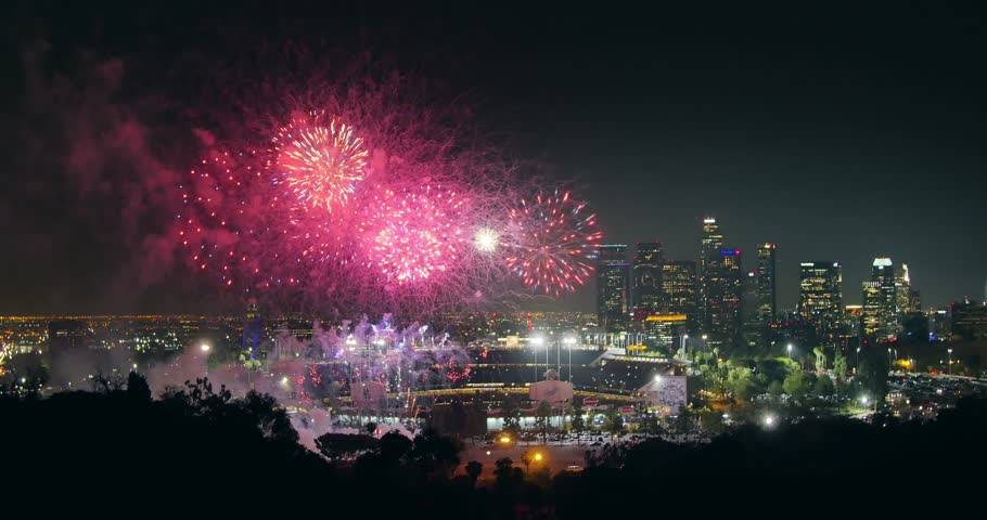 Fireworks display over city of Los Angeles downtown skyline at night. 4K UHD.