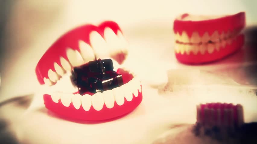 Chomping teeth wind up toy | Shutterstock HD Video #1063114