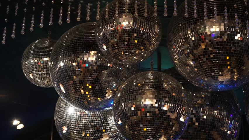 A mirror disco balls hanging from the ceiling stock footage video a mirror disco balls hanging from the ceiling stock footage video 10648247 shutterstock aloadofball Image collections