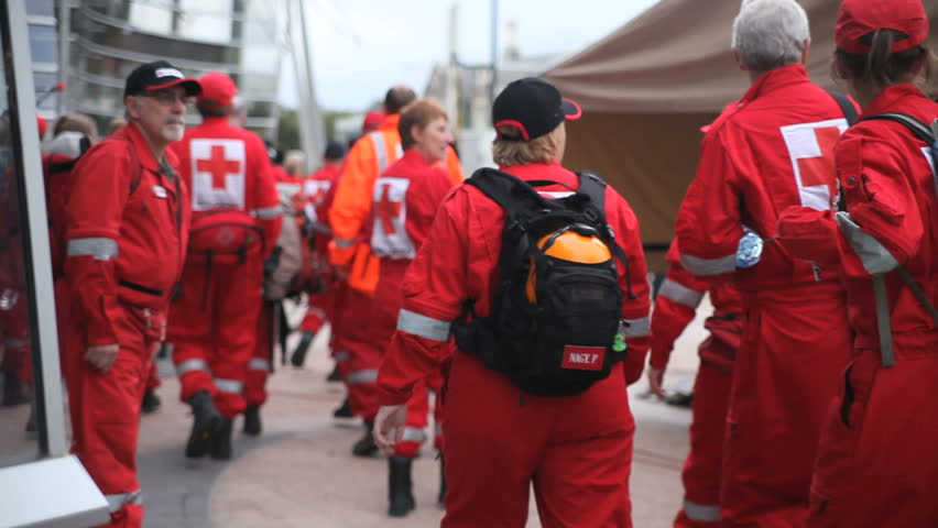 CHRISTCHURCH, NEW ZEALAND - FEB 23: Red Cross rescue workers return from search and rescue duty Feb 23rd, 2011. The Christchurch Earthquake devastated the city on Feb 22nd.