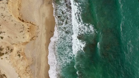 Aerial: Top shot of the coastline. Idyllic shot.