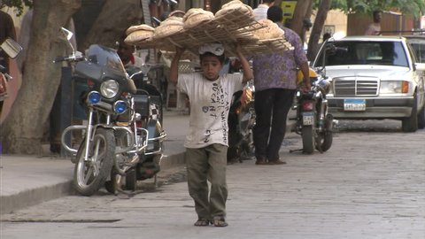 CAIRO - JUNE 24, 2010: Children selling bread in Cairo, Egypt