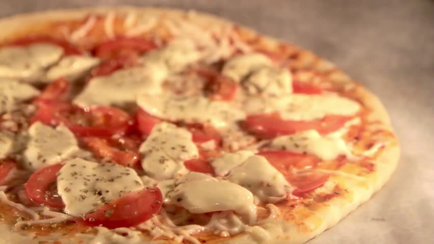 Pizza baking in oven ( Time Lapse HD Video)