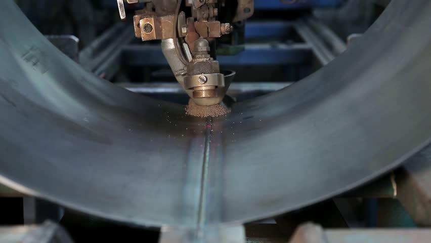 Video-footage: Submerged arc welding process of a vessel. Industrial machine | Shutterstock HD Video #10704515