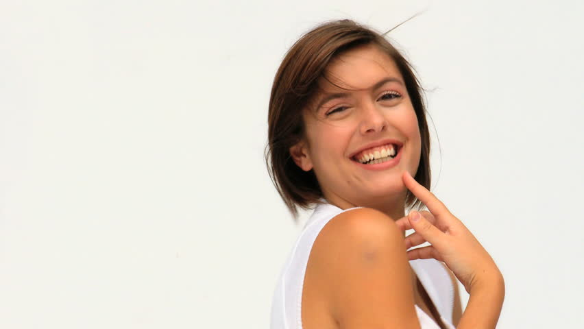 Attractive woman looking at the camera against a white background