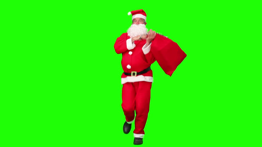 Chroma-key footage of Santa Claus dancing in costume