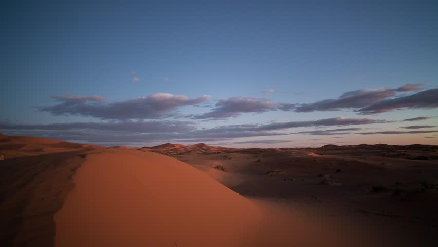 4k sunset timelapse of the amazing Erg chebbi dunes in the sahara desert, morocco #10756817