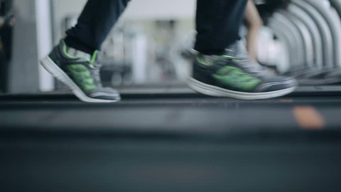 People in the gym treadmill cardio workout