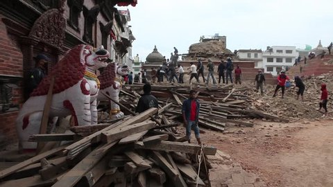 Kathmandu Durbar Square, Kathmandu Valley - 28th April, 2015:  People from Kathmandu cleaning up the rubbles in  Durbar Square after a huge 7.8M earthquake struck Nepal on 25th April, 2015.