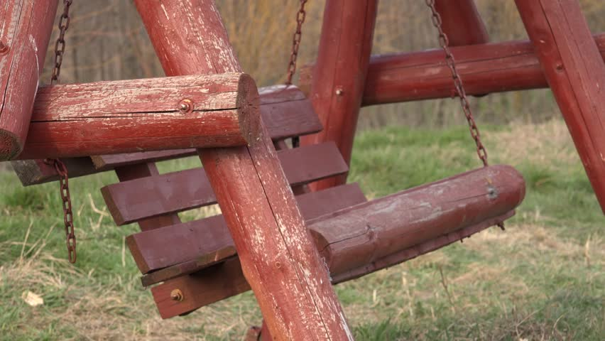4K Closeup of rustic swing with empty chair in summer holiday in nature by day #10803746