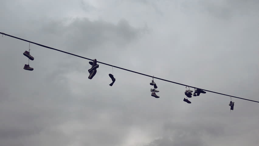 Hanging Pictures On Wire shoes on wire stock footage video 5456486 | shutterstock