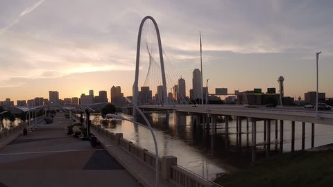Dallas skyline aerial at sunrise w two bridges and Trinity River reflection