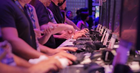 LOS ANGELES - June 17: Gamers testing demo video games at E3 2015 expo. Electronic Entertainment Expo, commonly known as E3, is an annual trade fair for the video game industry. 4K UHD