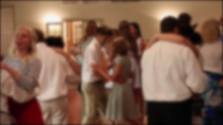 People dancing at a wedding reception at night indoors | Shutterstock HD Video #10942937