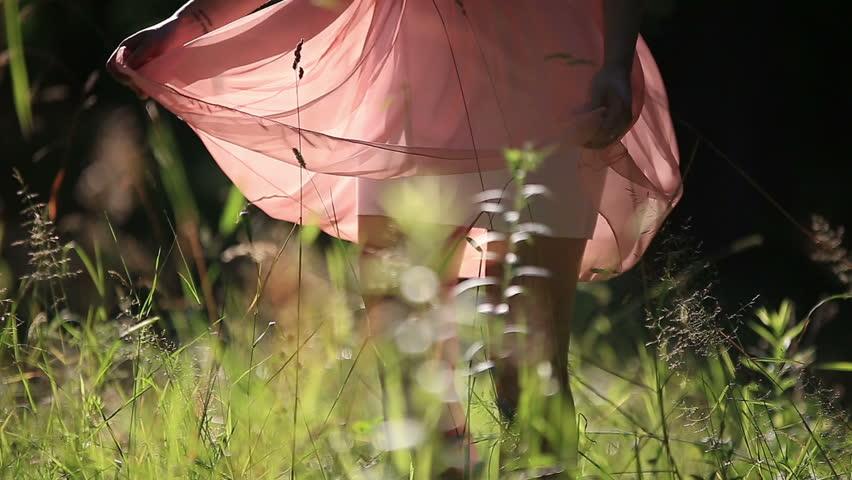 Girl Wearing Light Summer Dress Walking in the Field on Sunny Day Outdoors | Shutterstock HD Video #10958417