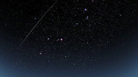 Meteor shower in the beautiful night sky.