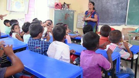 MAHARASHTRA, INDIA July 10, 2015: Rural school children studding in the class, July 10, 2015, Salunkwadi, Ambajogai, Beed, Maharashtra, India