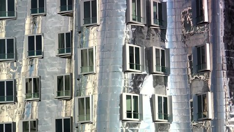 DUSSELDORF, GERMANY - MAY 19, 2015: The buildings of Neuer Zollhof in the Media Harbor. The Neuer Zollhof buildings was designed by the famous American architect Frank O. Gehry and completed in 1998.