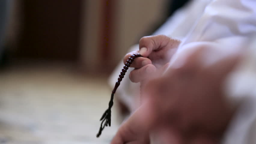 Muslim man use his prayer beads inside mosque at Amerli, Iraq. Amerli steadfastness to ISIS was a turning point in the war between Iraqi government and ISIS