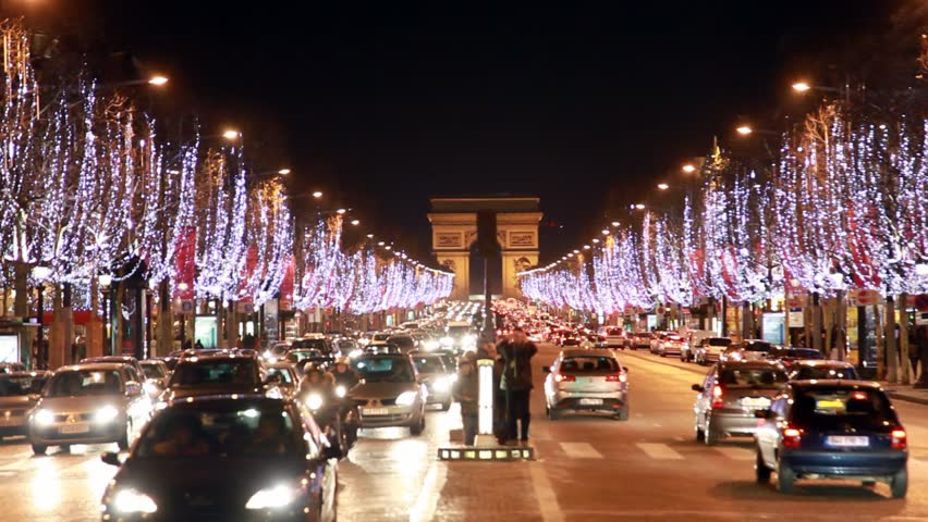 night traffic on the road near the Arc de Triomphe in Paris