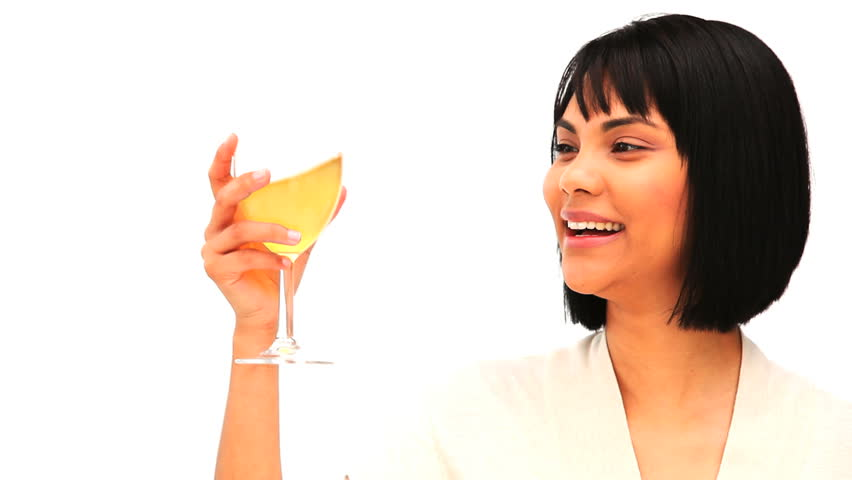 Attractive asian woman drinking a glass of white wine isolated on a white background | Shutterstock HD Video #1109827