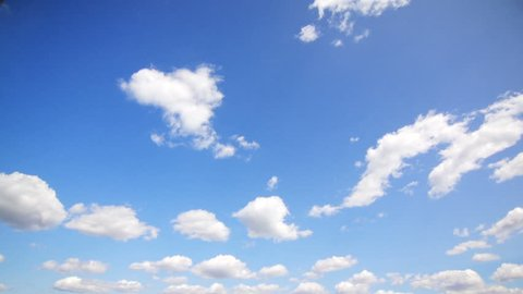 white clouds floating in the blue sky