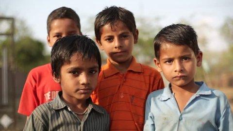 ANDHRA PRADESH, INDIA - CIRCA MAY 2013 - Village children in India smile and pose, close up