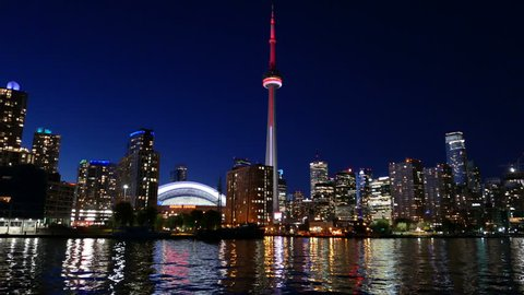 TORONTO - AUGUST 5, 2015: View of downtown Toronto, Canada skyline as seen from a smooth moving pan, shot at night.