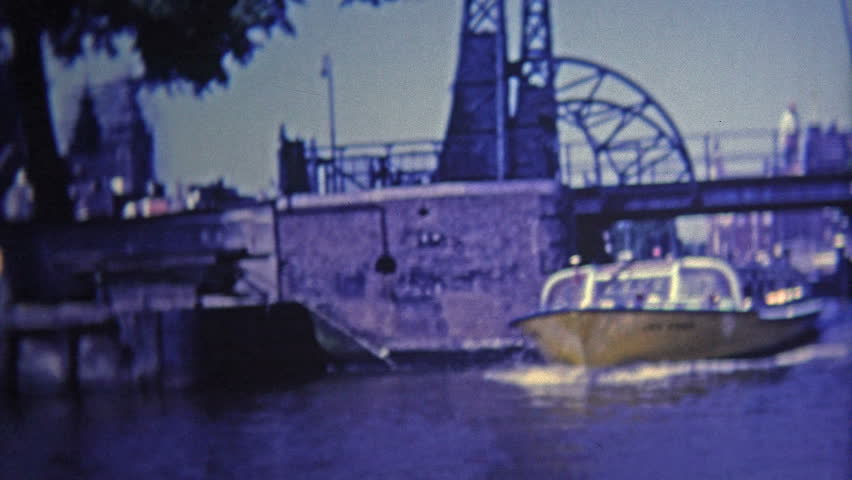 AMSTERDAM - 1969: Ride on boating canals and past classic bridges.