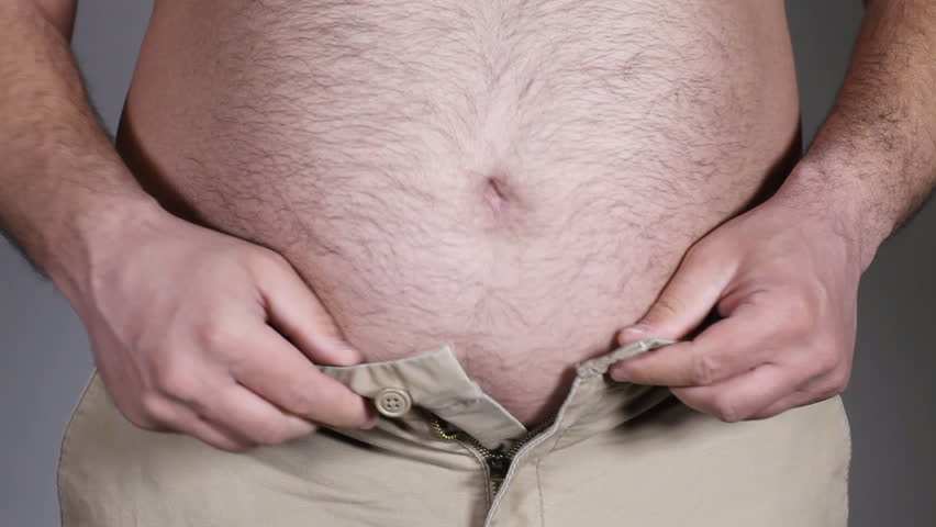 Fat man with a big belly can't button pants