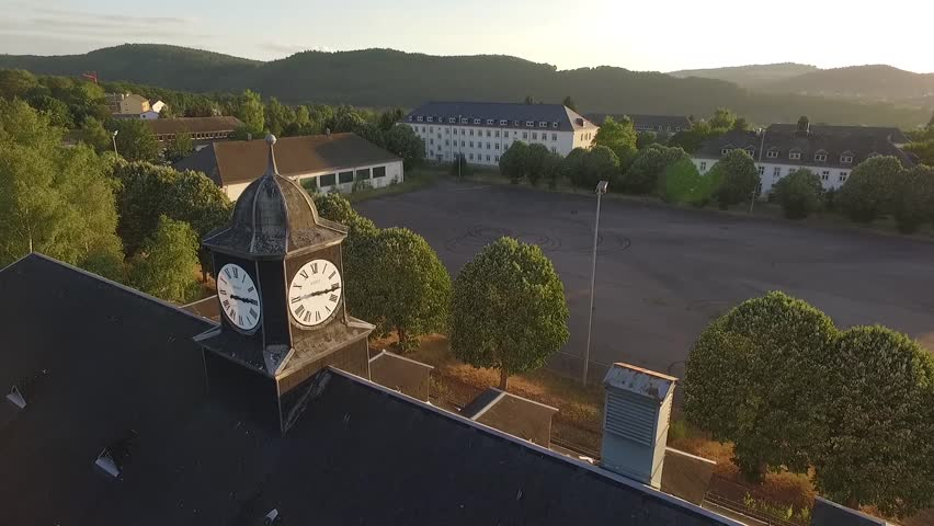 Aerial flight over a chapel clock and panorama of barracks and empty aerial flight over clock tower and chapel an empty square and old barracks in the thecheapjerseys Images