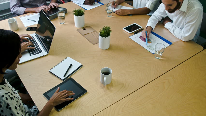 Group of diverse people working together on startup business idea in boardroom. | Shutterstock HD Video #11217434