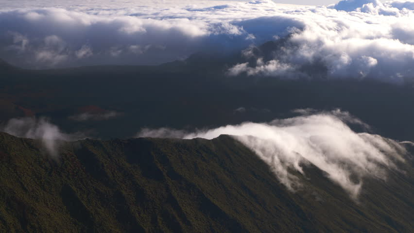 An aerial shot of the haleakala crater and the maui hawaiian island clouds starting to roll in on the haleakala crater in maui hawaii hd stock publicscrutiny Image collections