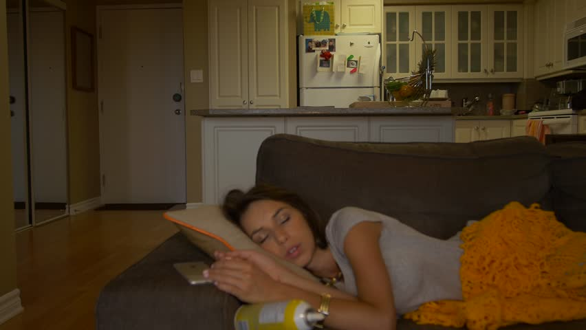 6ba3717aae Attractive woman sleeping on couch. B. By Big Bambi Productions. Stock  footage ID  11264777. Video clip ...