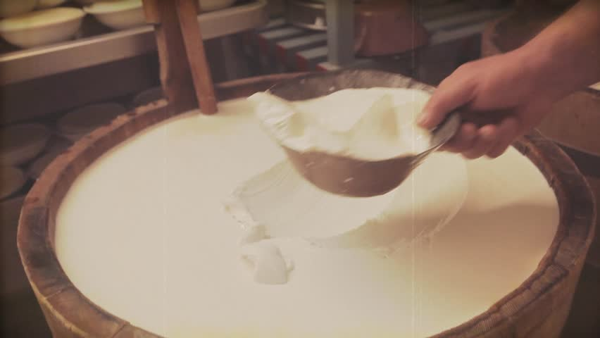 Reproduction of Vintage video. Making cheese traditional manually. Clip filtered to look like 1968 super 8 original video and The tools used to make cheese are the same as 60's  | Shutterstock HD Video #11275277