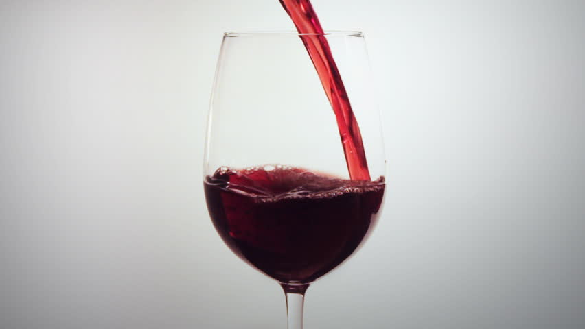 pouring red wine into glass. Shot in 60 fps.
