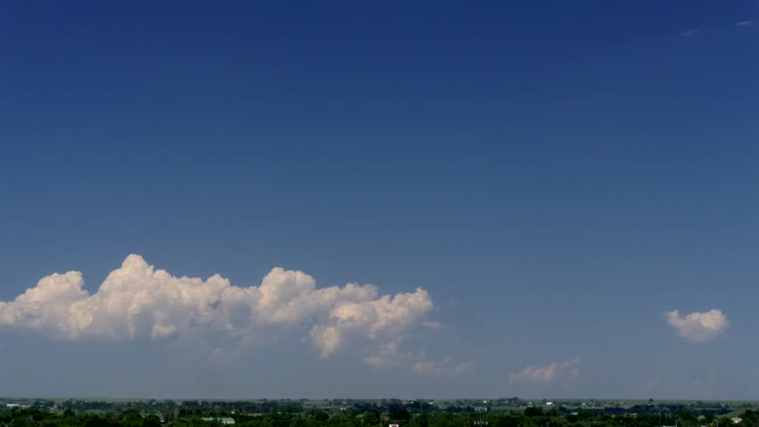 Cumulus Clouds Grow Up. A line of cumulus clouds grow vertically and reached Cumulonimbus status. Small anvil tops form and gradually become ice crystal clouds in the cold upper troposphere.