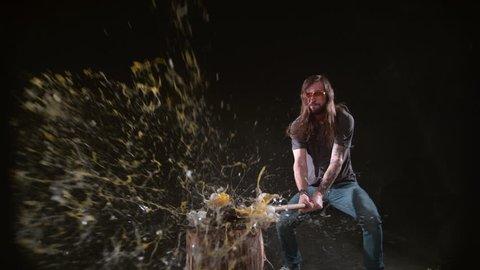 Man smashing eggs with hammer in slow motion, shot on Phantom Flex 4K at 1000 fps