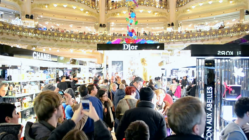 PARIS - DEC 30, 2014: Christmas decorated Galeries Lafayette department store on the Boulevard Haussmann on December 30, 2014 in Paris, France. Galeries Lafayette building was officially open in 1912.