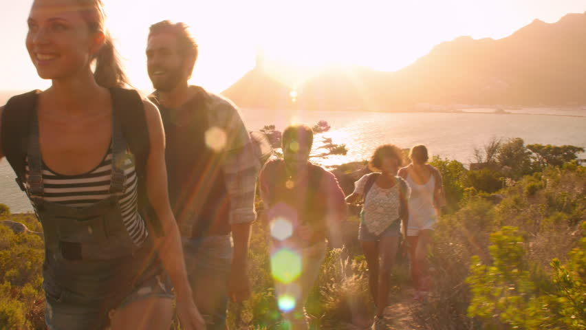 Group of friends walking along coastal path together | Shutterstock HD Video #11317337