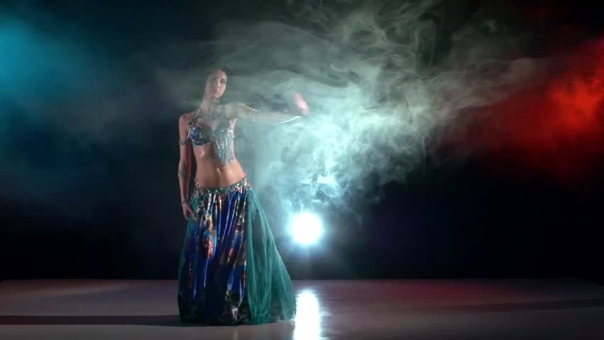 Talanted belly dance movements of young, great and attractive girl in exotic dress, whirling, slow motion, in smoke, black background, blue, red, blue #11331977