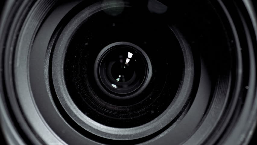 Camera lens zoom. Changing focal length. Front view macro shot. | Shutterstock HD Video #11333759