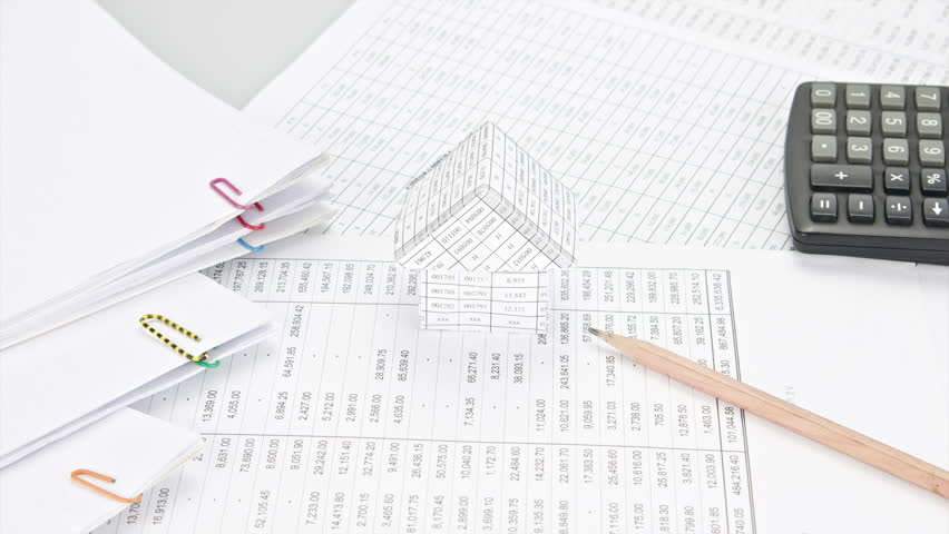 Pencil on finance account have house and calculator place with pile of paperwork like curves time lapse. Pile of document is increasing as work is going to be successful. Business concept footage. | Shutterstock HD Video #11334317