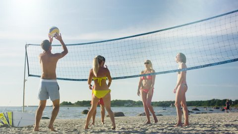 Group of Young People playing in Volleyball on the Beach. Shot on RED Cinema Camera in 4K (UHD).