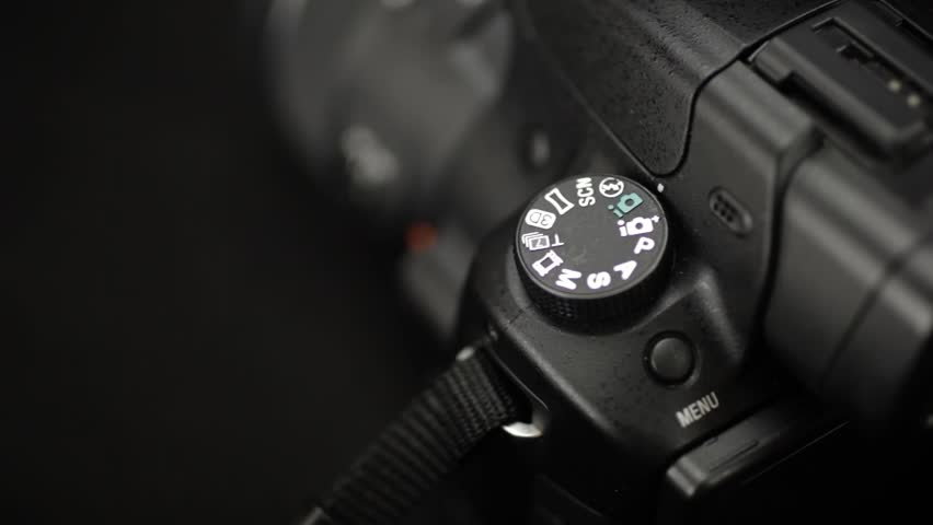 Hand Turning Wheel To Auto And Manual Mode on Camera #11390867
