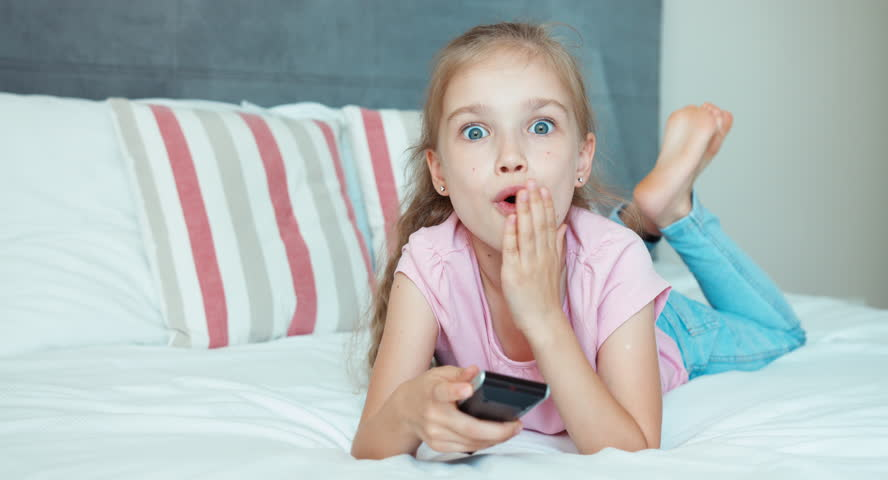 Laughing Girl Watching Tv Child Stock Footage Video 100 -1247