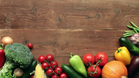 Moving vegetables on wooden background - stop motion animation